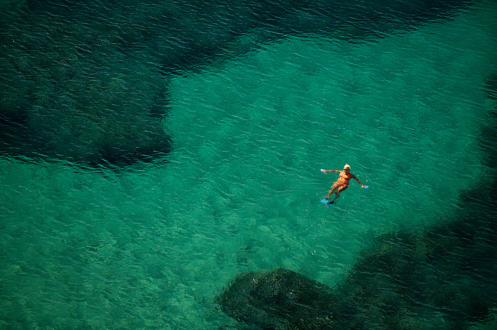 A woman enjoys the clear waters near Poros, Greece Sept 14, 2011. Photo Ken Cedeno