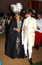 MR & MRS GAVIN BURKE, she is actress Nimmi March adopted daughter of the Duke of Richmond at the 2004 Goodwood Revival ball this year theme was a Venetian Masked Ball, held at Goodwood Motor Racing circuit, West Sussex on 4t September 2004.