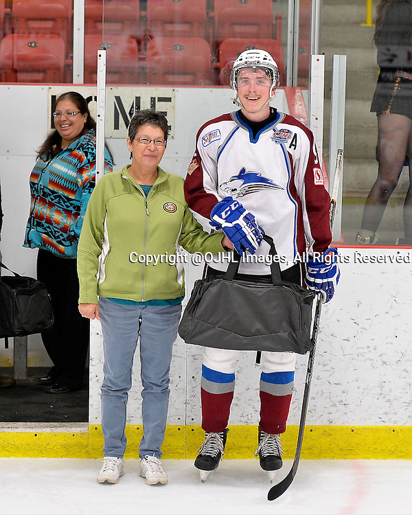 FORT FRANCES, ON - Apr 28, 2015 : Central Canadian Junior &quot;A&quot; Championship, game action between the Soo Thunderbirds and the Dryden GM Ice Dogs, game one of the Dudley Hewitt Cup. Matt Houston #9 of the Dryden GM Ice Dogs receives the player of the game award.<br /> (Photo by Shawn Muir / OJHL Images)
