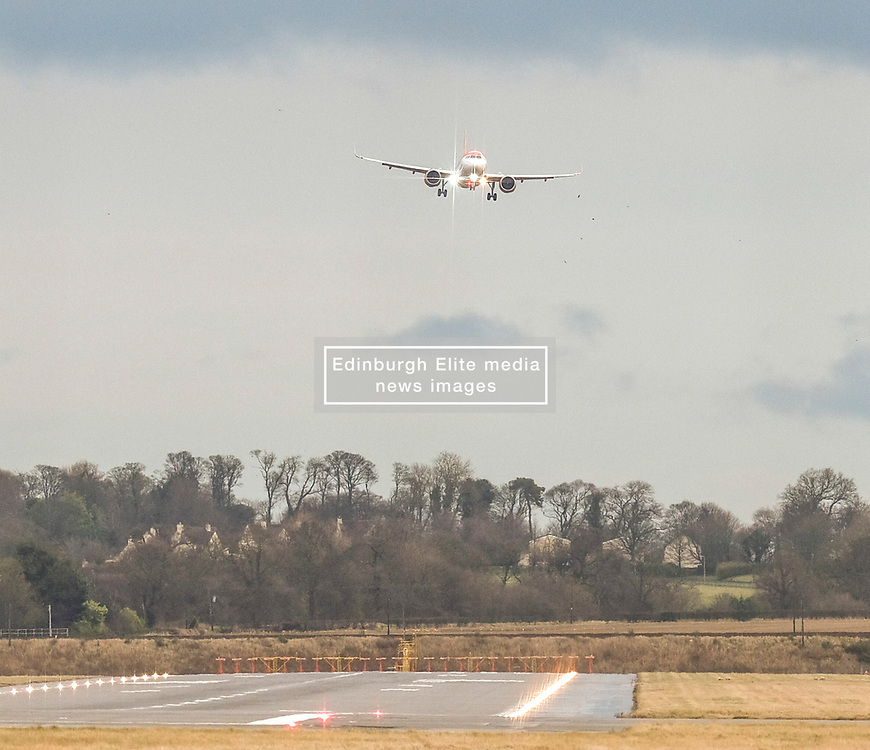 High Winds at Edinburgh Airport, Tuesday 7th January 2020<br /> <br /> Planes struggled on landing and take-off as high winds hit Edinburgh Airport today<br /> <br /> Pictured: An EasyJet flight struggles as it comes in to land<br /> <br /> Alex Todd   Edinburgh Elite media