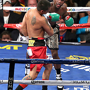 LAS VEGAS, NV - SEPTEMBER 13: Floyd Mayweather Jr. (R) punches Marcos Maidana during their WBC/WBA welterweight title fight at the MGM Grand Garden Arena on September 13, 2014 in Las Vegas, Nevada. (Photo by Alex Menendez/Getty Images) *** Local Caption *** Floyd Mayweather Jr; Marcos Maidana
