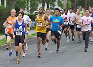 Middletown, New York - Runners race down Wallkill Avenue in the 16th annual Ruthie Dino-Marshall 5K Run/Walk put on by the Middletown YMCA on Sunday, June 10, 2012. ©Tom Bushey / The Image Works
