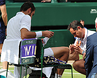 Tennis - 2017 Wimbledon Championships - Week Two, Sunday [Day Thirteen]<br /> 	<br /> Men Doubles Final match	<br /> <br /> Marin Cilic (CRO) vs Rodger Federer (SUI)<br /> 	<br /> Marin Cilic receives attention to his feet from the Doctor on  Centre court <br /> 	<br /> COLORSPORT/ANDREW COWIE