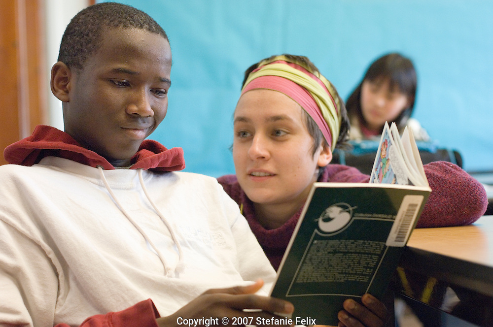 Volunteer tutor helps ESL student read in French at Secondary Bilingual Orientation Center, Seattle