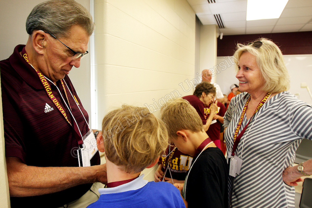A grandparent reads zombie facts to a group of children during an activity in Anspach Hall photo by Emily Mesner