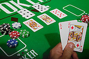 A young male gambler at the gambling with a winning hand table model release available