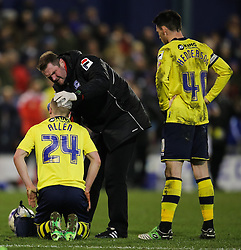 Rochdale's Jamie Allen receives treatment for a head injury  - Photo mandatory by-line: Matt McNulty/JMP - Mobile: 07966 386802 - 24/03/2015 - SPORT - Football - Oldham - Boundary Park - Oldham Athletic v Rochdale - SkyBet League 1