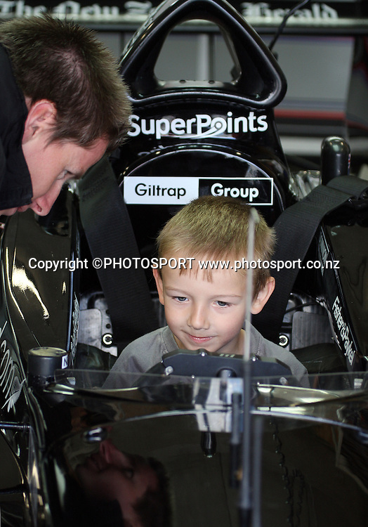 5 year old Toby Lipinski from Tauranga enjoys being in the hot seat of the Team NZ car Black Beauty.<br />