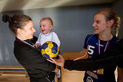 Jelena Grubisic of Krim with Luka, son of Barbara Varlec Lazovic after the last game of 1st A Slovenian Women Handball League season 2011/12 between ZRK Krka and RK Krim Mercator, on May 8, 2012 in Stopice at Novo mesto, Slovenia. RK Krim Mercator became Slovenian National Champion, GEN-I Zagorje placed second and ZRK Krka placed third. (Photo by Vid Ponikvar / Sportida.com)