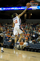 UVA's Britnee Millner (12) shoots an uncontest layup after a fast break against Wake Forest.  The Cavaliers defeated the Demon Deacon 77-71 on January 11, 2007 for their first ACC win in the John Paul Jones Arena in Charlottesville, VA.<br />