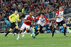 July 15, 2017 - Sydney, New South Wales, Australia - Wanderers player, Jumpei Kusukami and Arsenal player, Theo Walcott chase down the ball.FA Cup Champions Arsenal wins 3-1 over Western Sydney Wanderers FC at ANZ Stadium. (Credit Image: © United Images/Pacific Press via ZUMA Wire)