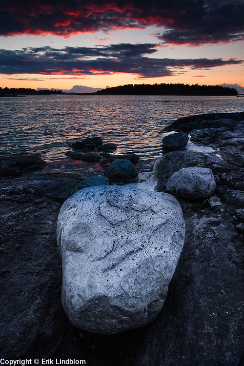A big bright granite rock on the shore of Nåttarö, a small island in Stockholm archipelago.