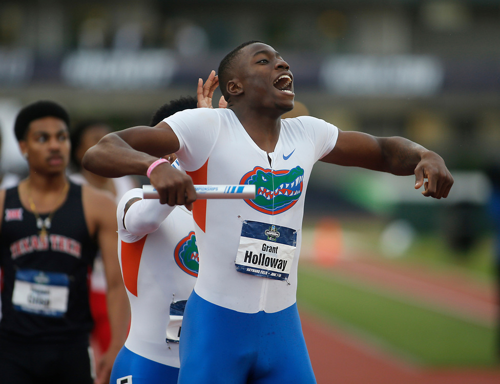 Florida's Grant Holloway celebrates after realizing that the Gator's won the men's team championship on the third day of the NCAA outdoor college track and field championships in Eugene, Ore., Friday, June 9, 2017. (AP Photo/Timothy J. Gonzalez)