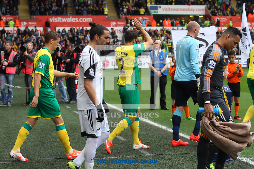 Russell Martin of Norwich applauds the traveling support before the Barclays Premier League match at the Liberty Stadium, Swansea<br /> Picture by Paul Chesterton/Focus Images Ltd +44 7904 640267<br /> 29/03/2014