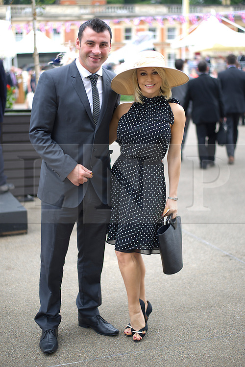 © London News Pictures. 18/06/2013. Ascot, UK.  Joe Calzaghe and girlfriend Kristina Rihanoff  arriving on day one of Royal Ascot at Ascot racecourse in Berkshire, on June 18, 2013.  The 5 day showcase event,  which is one of the highlights of the racing calendar, has been held at the famous Berkshire course since 1711 and tradition is a hallmark of the meeting. Top hats and tails remain compulsory in parts of the course. Photo credit should read: Ben Cawthra/LNP
