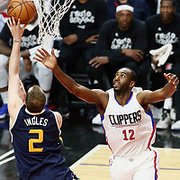 15 April 2017: Utah Jazz forward Joe Ingles (2) goes for the lay up past LA Clippers forward Luc Mbah a Moute (12) during the Utah Jazz 97-95 victory over the Los Angeles Clippers, during game 1 of the first round of the Western Conference playoffs, at the Staples Center, Los Angeles, California, USA.