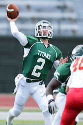19 September 2015:  Frank Toland (52) holds off Jake Stearns as Jack Warner (2) throws a pass during an NCAA division 3 football game between the Simpson College Storm and the Illinois Wesleyan Titans in Tucci Stadium on Wilder Field, Bloomington IL