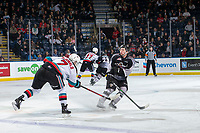 KELOWNA, BC - JANUARY 4: Jackson Shepard #18 of the Vancouver Giants attempts to block a pass by Conner McDonald #7 of the Kelowna Rockets during second period at Prospera Place on January 4, 2020 in Kelowna, Canada. (Photo by Marissa Baecker/Shoot the Breeze)