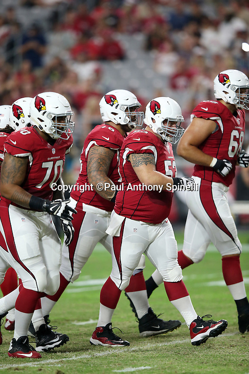 Arizona Cardinals center A.Q. Shipley (53) and the offensive line head to the line of scrimmage during the 2015 NFL preseason football game against the Kansas City Chiefs on Saturday, Aug. 15, 2015 in Glendale, Ariz. The Chiefs won the game 34-19. (©Paul Anthony Spinelli)