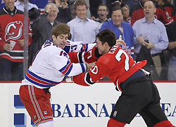 Mar 6; Newark, NJ, USA; New York Rangers left wing Brandon Dubinsky (17) and New Jersey Devils center Ryan Carter (20) fight during the first period at the Prudential Center.