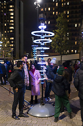 © Licensed to London News Pictures. 20/11/2019. London, UK. Light installation titled Illumaphonium: Halos showing as part of Winterfest 2019 at Wembley Park. Photo credit: Ray Tang/LNP