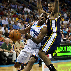 April 11, 2011; New Orleans, LA, USA; New Orleans Hornets point guard Chris Paul (3) drives past Utah Jazz point guard Earl Watson (11) during a game at the New Orleans Arena. The Jazz defeated the Hornets 90-78.  Mandatory Credit: Derick E. Hingle