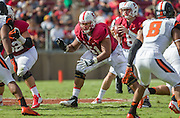 PALO ALTO, CA -  OCTOBER 25:  Joshua Garnett #51, an offensive lineman for the Stanford University Cardinal, prepares to block during a PAC-12 NCAA football game against the Oregon State University Beavers played on October 25, 2014 at Stanford Stadium on the campus of Stanford University in Palo Alto, California.  Visible in background is quarterback Kevin Hogan #8.   (Photo by David Madison/Getty Images) *** Local Caption *** Joshua Garnett