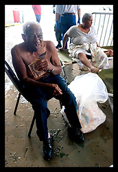 30th August, 2005. Triage at the Superdome in New Orleans. An elderly man tucks into an MRE, his first food in 2 days, rescued from the flooded lower 9th ward.