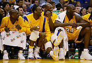 The Lakers' Gary Peyton, Kobe Bryant, Karl Malone and Shaquille O'Neal enjoy the closing minutes of a victory from the bench.