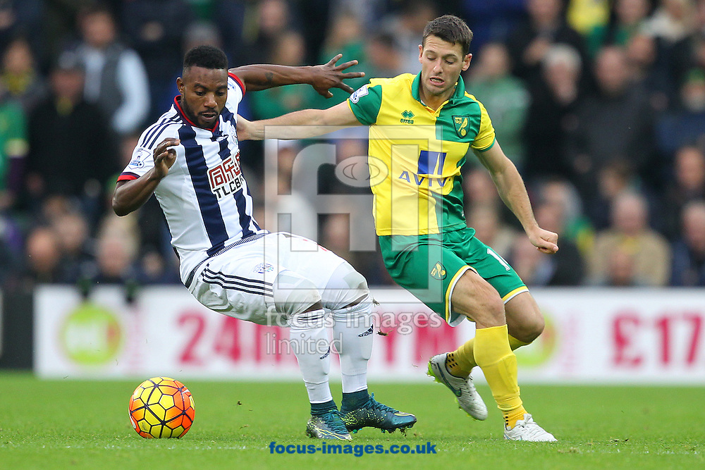 Wes Hoolahan of Norwich and Stephane Sessegnon of West Bromwich Albion in action during the Barclays Premier League match at Carrow Road, Norwich<br /> Picture by Paul Chesterton/Focus Images Ltd +44 7904 640267<br /> 24/10/2015