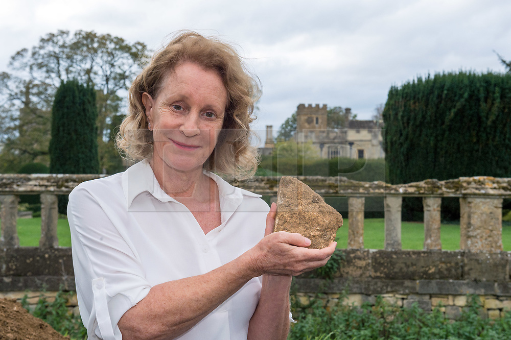 © Licensed to London News Pictures. 13/10/2018. Winchcombe, Gloucestershire, UK. Sudeley Castle. Historical novelist Dr PHILIPPA GREGORY holds a piece of masonry found by archaeologists from DigVentures who hope to unearth a long-lost Tudor garden at Sudeley Castle this weekend. Philippa, who's well-known works include The Other Boleyn Girl and The White Queen, started her research into Sudeley Castle whilst working on a novel about Katherine Parr. For nearly 1,000 years, Sudeley Castle has hosted some of England's most famous monarchs including Henry VIII. It is also where Katherine Parr, Henry's last wife, later lived and was finally laid to rest. A recent geophysical survey at Sudeley revealed the ghostly outline of a long-lost Tudor garden, with traces of what could have been a banqueting house in the same area where pieces of Tudor masonry were found in the 19th century. Now experts say it is time to investigate further. The dig will take place at this Saturday and Sunday, October 13 and 14, and is thought to be the most significant archaeological investigation since the discovery of Roman villas on the estate in Victorian times. A specialist team from social archaeology company, DigVentures, will begin an investigation of the site, which aims to 'ground-truth' the geophysics results. They hope to reveal some of the Tudor secrets that remain hidden underground at the castle. Following the popular landscaping movement inspired by Capability Brown, many Tudor gardens were lost, and this is perhaps just one of only two in England where the original paths remain visible. Photo credit: Simon Chapman/LNP