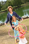 Grandmother Playing Hula Hoop With Her Granddaughters
