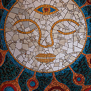 Mosaic of face with 3rd eye on wall inside entrance to PATH Station on 9th Street in NYC.