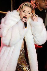 60880148<br /> Miley Cyrus performs live at the New Years Eve celebrations in Times Square, Tuesday, 31st December 2013. Picture by  imago / i-Images<br /> UK ONLY