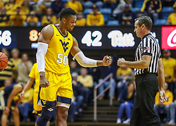 Dec 8, 2018; Morgantown, WV, USA; West Virginia Mountaineers forward Sagaba Konate (50) reacts and gives an official a fist bump after being called for a foul during the second half against the Pittsburgh Panthers at WVU Coliseum. Mandatory Credit: Ben Queen-USA TODAY Sports