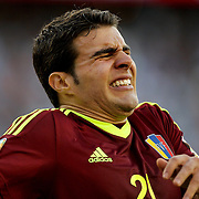 FOXBOROUGH, MASSACHUSETTS - JUNE 18:  Alexander Gonzalez #21 of Venezuela feels the pain after a tackle during the Argentina Vs Venezuela Quarterfinal match of the Copa America Centenario USA 2016 Tournament at Gillette Stadium on June 18, 2016 in Foxborough, Massachusetts. (Photo by Tim Clayton/Corbis via Getty Images)