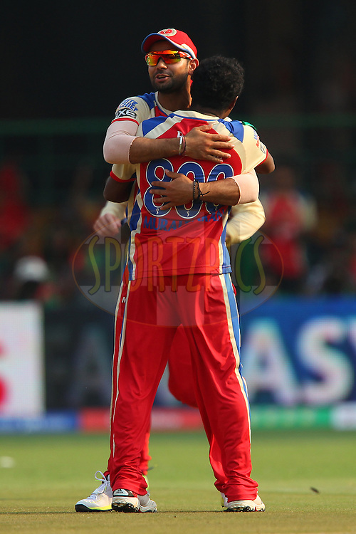 Muttiah Muralitharan celebrates the wicket of Parthiv Patel with Virat Kohli during match 9 of of the Pepsi Indian Premier League between The Royal Challengers Bangalore and The Sunrisers Hyderabad held at the M. Chinnaswamy Stadium, Bengaluru  on the 9th April 2013..Photo by Ron Gaunt-IPL-SPORTZPICS   ..Use of this image is subject to the terms and conditions as outlined by the BCCI. These terms can be found by following this link:..http://www.sportzpics.co.za/image/I0000SoRagM2cIEc