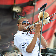"""COLUMBIA, MD - SEPTEMBER 25th, 2010:  Troy """"Trombone Shorty"""" Andrews and his brass band perform at the 2010 Virgin Mobile FreeFest at Merriweather Post Pavilion. (Photo by Kyle Gustafson/For The Washington Post)"""