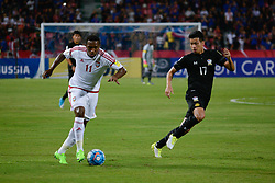 June 13, 2017 - Bangkok, Bangkok, Thailand - AHMED KHALIL (L) of the UAE in action against Thailand's Tanaboon KESARAT (R) during the FIFA World Cup 2018 qualifying soccer match between Thailand and the United Arab Emirates at the Rajamangala stadium in Bangkok, Thailand, 13 June 2017. (Credit Image: © Anusak Laowilas/NurPhoto via ZUMA Press)