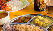 Close up of curry meal and local Lion lager beer, Mirissa, Sri Lanka, Asia