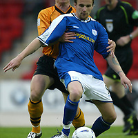 St Johnstone v Alloa..CIS Cup 1st Round...10.08.04<br />Brown Ferguson gets to grips with Ryan Stevenson<br /><br />Picture by Graeme Hart.<br />Copyright Perthshire Picture Agency<br />Tel: 01738 623350  Mobile: 07990 594431