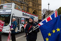 "A Leave Means Leave campaign Bus carrying the slogan ""Believe In Britain"" and ""Stop the Brexit Betrayal"" passes Leave and Remain protesters outside Parliament. London, January 07 2019."