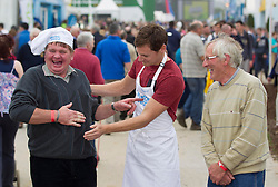 NO REPRO FEE: (L-R) A well fed Pat Prendergast from Claremorris and Aidan Wallace from Duncannon Newross Co Wexford (right) pictured with Celebrity MasterChef winner David Gillick who was cooking up a storm at the Electric Ireland stand at the 2013 National Ploughing Championships yesterday. With three showcase demonstrations each day, David is creating some of his favourite healthy dishes for visitors to the Electric Ireland stand. Picture Andres Poveda