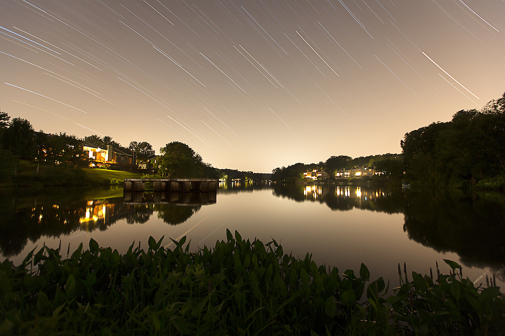 """Density"". Seemingly idyllic Lake Audubon, in the planned community of Reston, VA, is located on the Snakeden Branch of Difficult Run and it is one of the most heavily impacted sections of Difficult Run, mostly due to population density and the high percentage of impervious surfaces surrounding this part of the watershed. The sky color and brightness is light pollution from the surrounding homes, businesses, highways, and distant airport. This image is part of my project ""Difficult Run: Dreamscapes and Nightmares Along Four Northern Virginia Streams""."