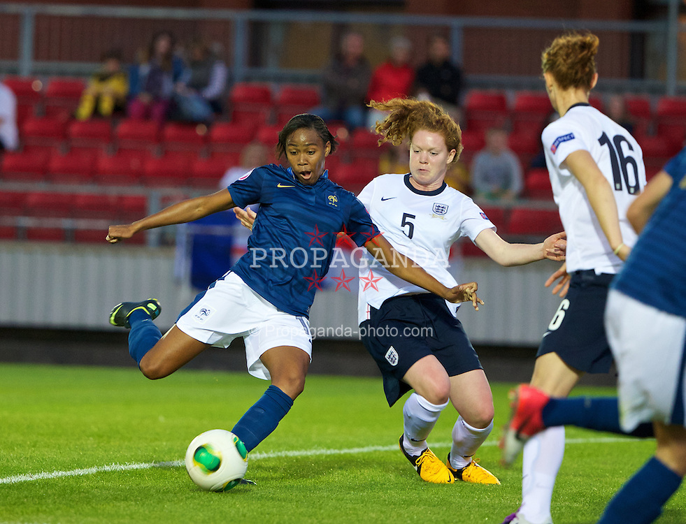 LLANELLI, WALES - Monday, August 19, 2013: England's Felicity Gibbons in action against France's Lindsey Thomas during the Group A match of the UEFA Women's Under-19 Championship Wales 2013 tournament at Stebonheath Park. (Pic by David Rawcliffe/Propaganda)