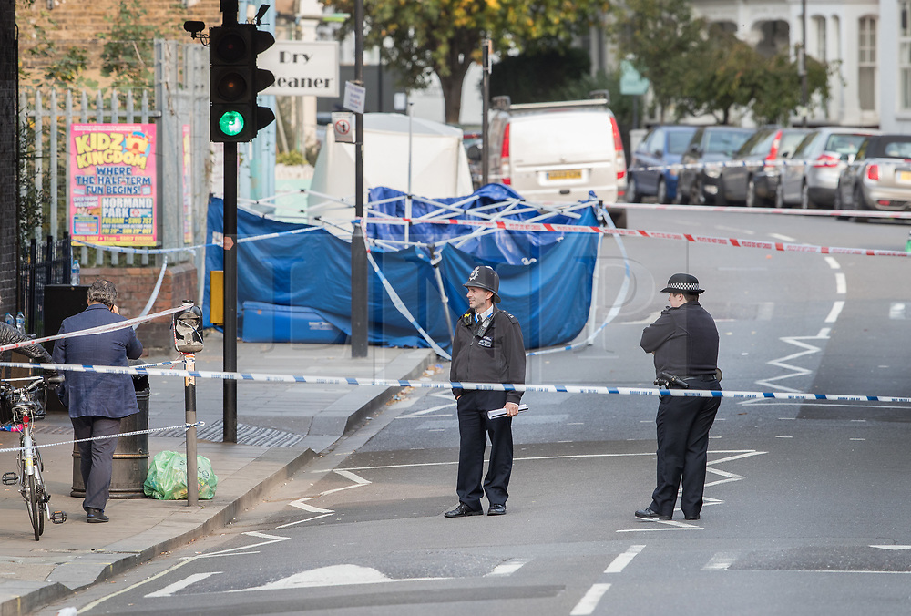© Licensed to London News Pictures. 17/10/2017. London, UK. A police tent covers the crime scene. Police are investigating after a man in his 20's was stabbed to death and two others were injured in an incident on Monday night outside Parsons Green underground station a terrorist attack took place last month. Photo credit: Peter Macdiarmid/LNP