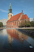 The Marienkirche or St Mary's Church, originally 13th century but comprehensively restored in the 19th and 20th centuries, with the fountains in Alexanderplatz in the foreground, Berlin, Germany. Picture by Manuel Cohen