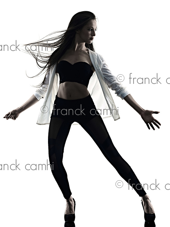 one young beautiful long hair caucasian woman modern ballet disco dancer dancing studio shot silhouette shadow isolated on white background
