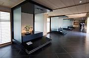 Bonsai trees and garden stones are displayed at the Saitama Omiya Bonsai Museum of Art in Saitama, Japan on 15 Aug. 2011..Photographer: Robert Gilhooly