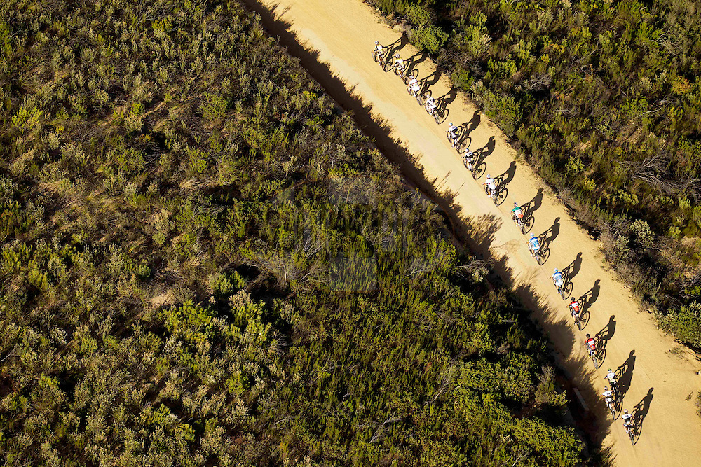 LOURENSFORD - Riders climb near Coetzenberg during the final stage (stage 7) of the 2013 Absa Cape Epic Mountain Bike stage race from Stellenbosch to Lourensford Wine Estate in Somerset West, South Africa on the 24 March 2013..Photo by Gary Perkin/Cape Epic/SPORTZPICS